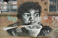 Tag d'un enfant asiatique sur un mur